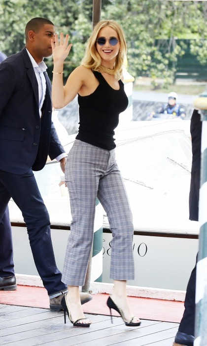 Hey, J-Law! Jennifer Lawrence looked chic while making her first official Venice Film Festival appearance earlier in the day. The star wore a simple black tank, checkered cropped pants, pearl-embellished heels and gold accessories. 