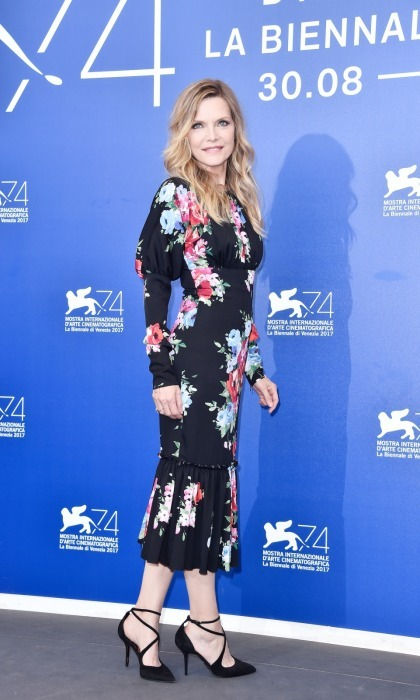 Michelle Pfeiffer opted for a floral midi dress and sleek black-wrapped heels for the photocall. 