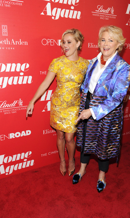 Reese Witherspoon was a ray of sunshine in a Michael Kors Collection yellow sheath dress with Jimmy Choo pumps alongside Candice Bergen at the Cinema Society screening of <i>Home Again</i> in NYC.  Guests were treated to Lindt LINDOR red milk chocolate truffles at The Skylark for the film's afterparty in NYC.