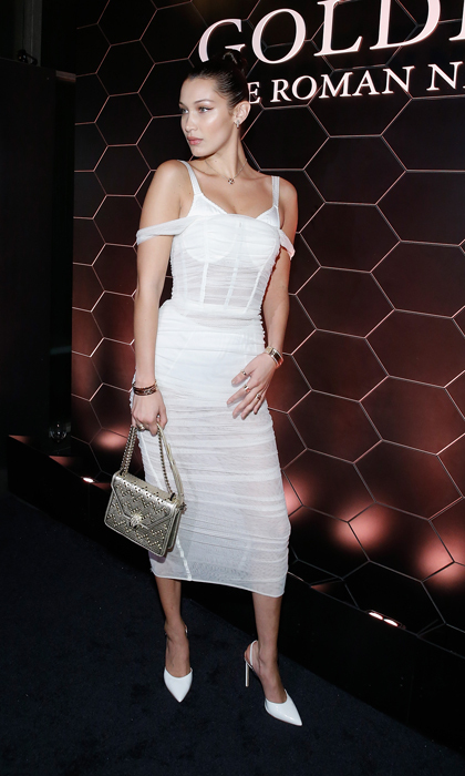 Bella Hadid, in Dolce & Gabbana, proved you can wear white after Labor Day at the Bulgari fragrance launch of Goldea, The Roman Night at 1 Hotel Brooklyn Bridge in New York on September 6.