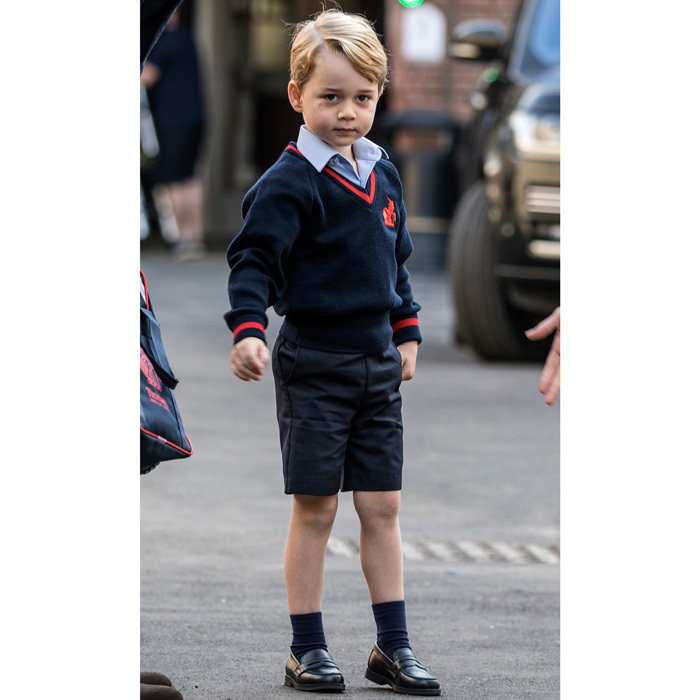 Princess Charlotte's older brother looked sharp in his school uniform, which consisted of a sky blue button-down shirt, navy shorts and a navy sweater with the school's logo. The young royal also sported a small bruise under his right eye.
