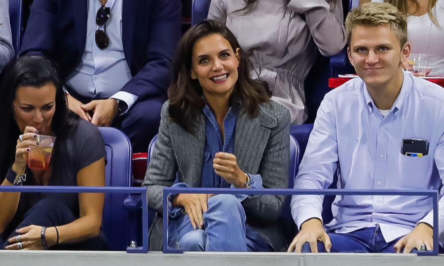 Katie Holmes took a break from fashion week to watch the women's semi final matches during the US Open.