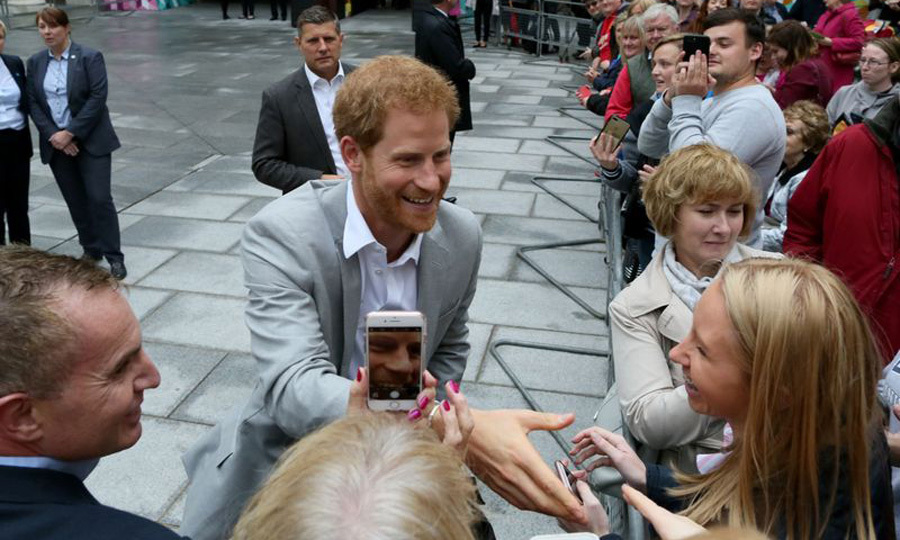 That's some close up! Prince Harry was greeted by fans and phones as he visited Cathedral quarter in Belfast during his first trip to Northern Ireland on September 7.