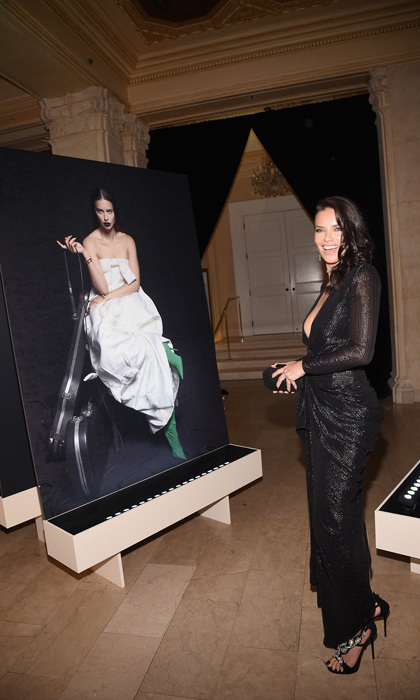 Here's looking at you girl! Adriana Lima checked out her Bazaar shot inside the party.