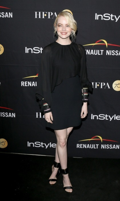 Emma Stone made her way to Toronto after the US Open in NYC and attended the HFPA & InStyle party at Windsor Arms Hotel.