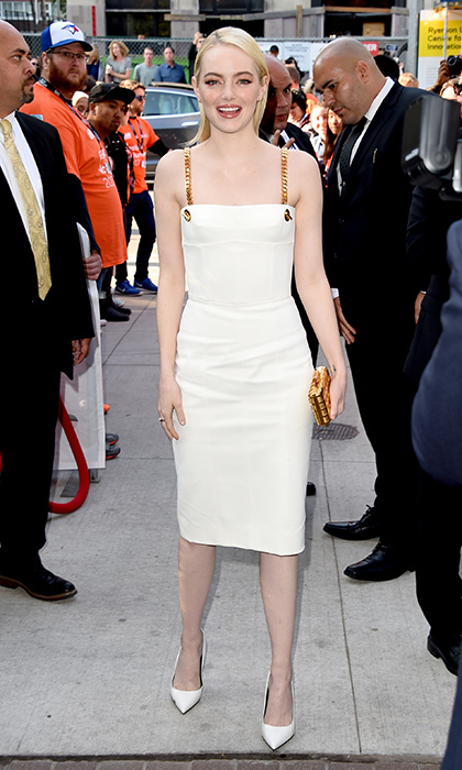Emma Stone rocked gold eyeshadow to match the chain detail on her Tom Ford little white dress at the 'Battle of the Sexes' premiere. 