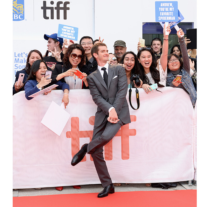 "Fans held ""You're my favorite Spiderman"" signs as Andrew Garfield mingled with the crowd at the premiere of <I>Breathe</I>. 