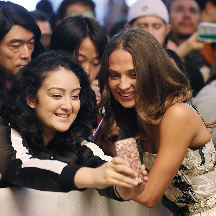 Smile! Alicia Vikander stopped for a selfie as she walked the red carpet for <I>Euphoria</I>.