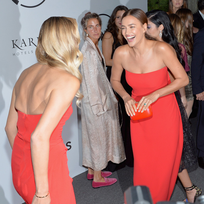 Irina Shayk and Natasha Poly were seeing double on the Unitas Gala red carpet when they wore similar red dresses.