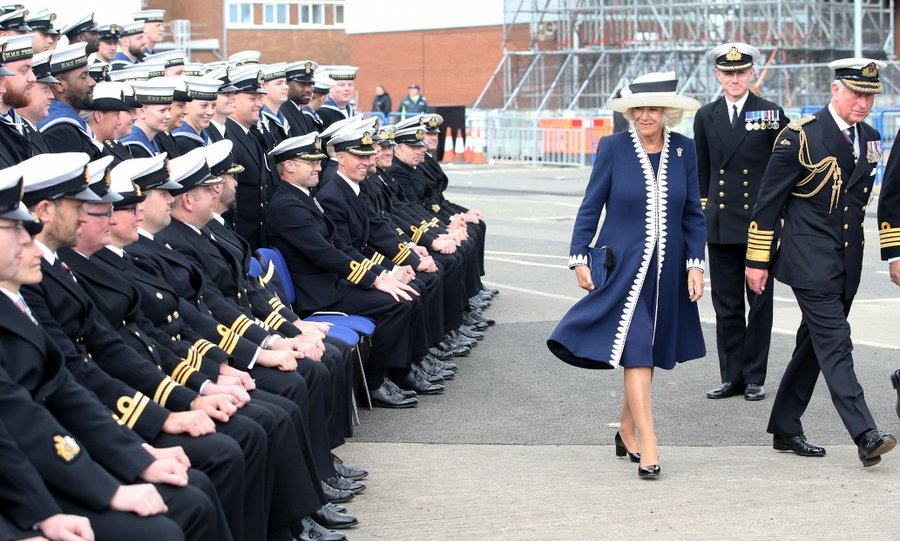 Duchess Camilla had the attention of the sailors after posing for a group photograph at the naming ceremony of the <I>HMS Prince of Wales</I> at the Royal Dockyard in Fife, Scotland. 