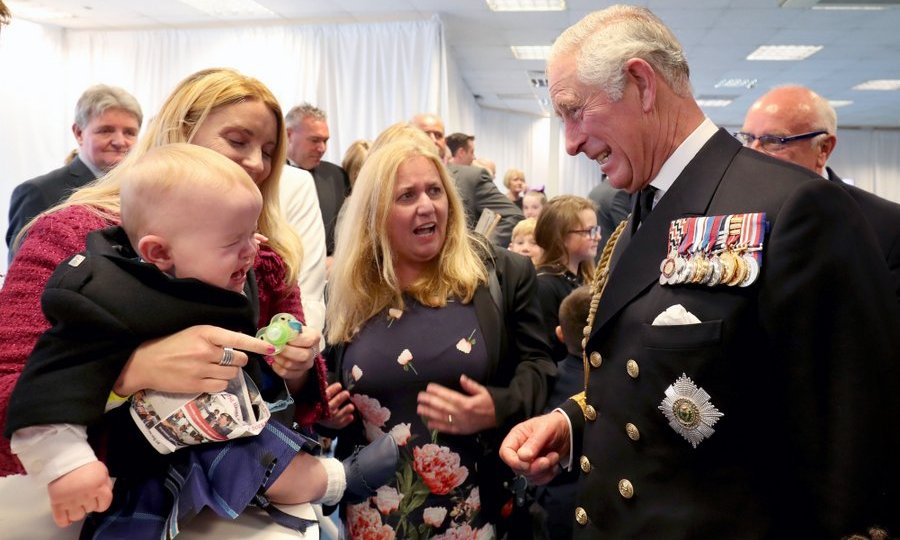 Prince Charles – styled as the Duke of Rothesay while in Scotland – seemed to empathize with shy 11-month-old Myles Johnston at a reception following the official naming ceremony of aircraft carrier <I>HMS Prince of Wales</I> in Fife.