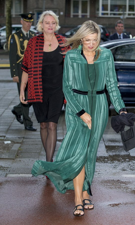 Wearing flat sandals in the rainy weather, Queen Maxima of the Netherlands nearly got swept away by pre-autumn winds at the LOEY awards in Amsterdam on September 11. 