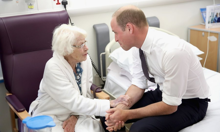 Prince William demonstrated he has inherited mom Princess Diana's special touch while speaking with Theresa Jones in the Frailty unit during a visit to Aintree University Hospital on September 14 in Liverpool, England. 
