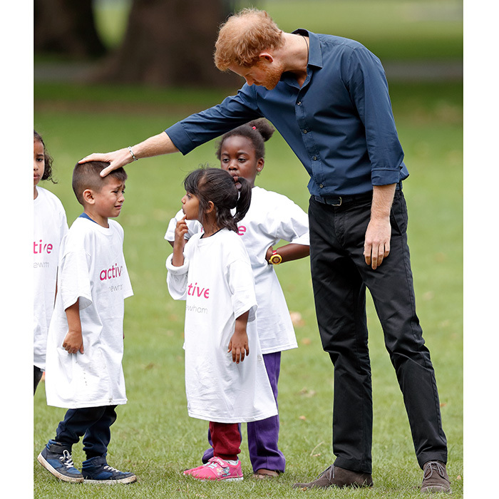 In July 2017, Prince Harry put his comforting skills to the test with this little boy who burst into tears during a StreetGames 'Fit and Fed' summer holiday activity session in Central Park, East Ham in London, England. 
