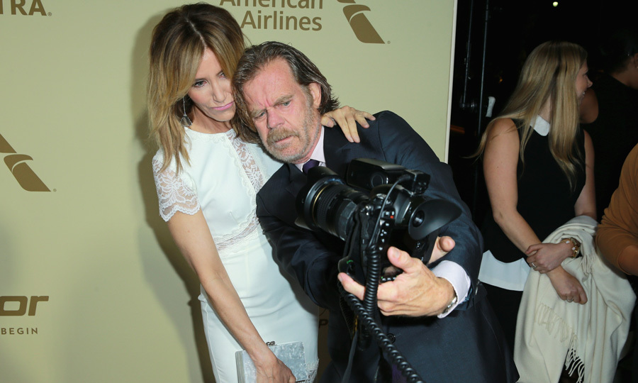 William H. Macy took over as photographer to capture this red carpet moment with wife Felicity Huffman at The Hollywood Reporter and SAG-AFTRA's Emmy Nominees Night party at the Waldorf Astoria.
