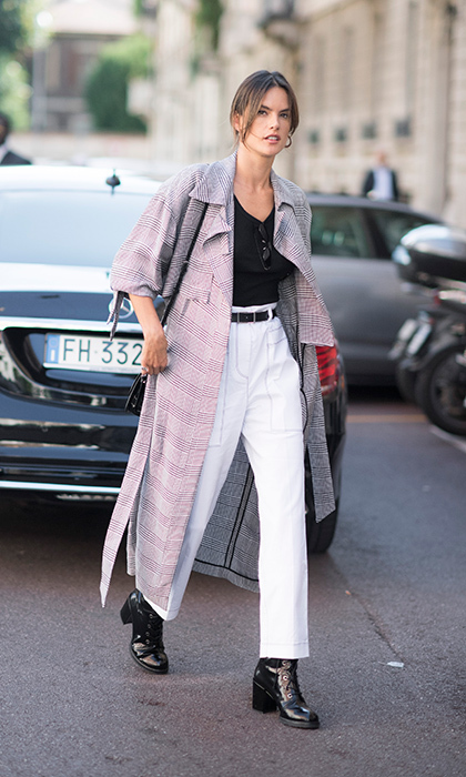 Street style watch: Alessandra Ambrosio embraced the masculine trend in trousers, boots and a loose trench. 