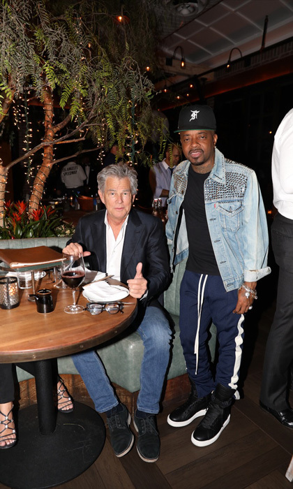 David Foster and Jermaine Dupri paused midmeal at Catch L.A.'s first anniversary party on September 18.