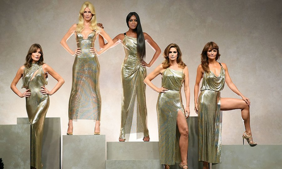 In a return of the 1990s supermodels, model and former French First Lady Carla Bruni, Claudia Schiffer, Naomi Campbell, Cindy Crawford and Helena Christensen struck a pose at Versace, honoring their late friend Gianni Versace. In another homage, the iconic catwalk stars closed the show by strutting their stuff on the runway to <I>Freedom</I> by the late George Michael, another much-missed loved one from the era. 