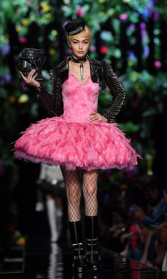 A fun feathered look, modeled by Gigi Hadid, at Moschino.