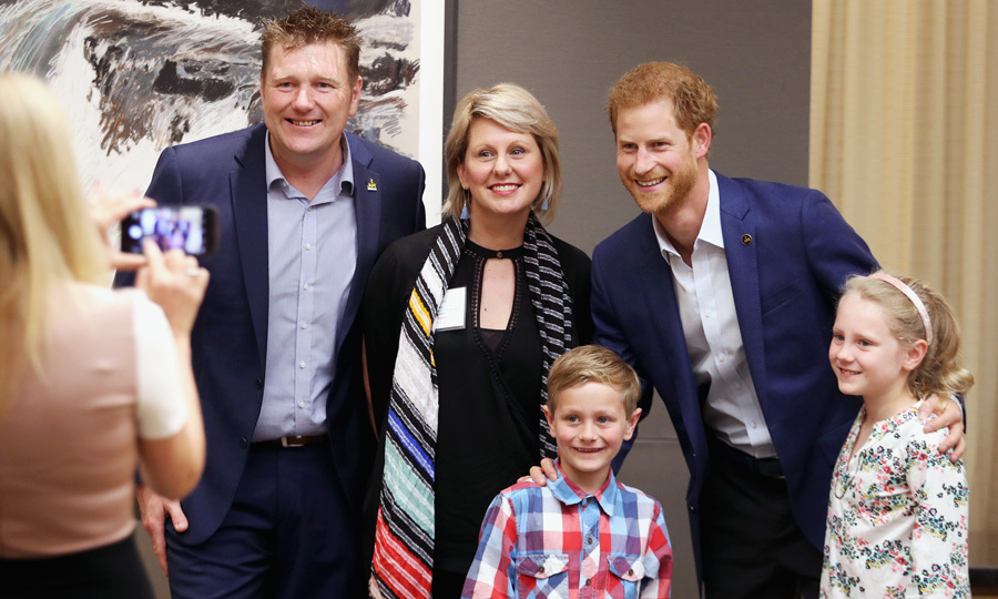 Say cheese! Prince Harry posed for a photo with Karen, Mark and their children before they took the stage at the True Patriot Love Symposium to discuss the impact of injury on families.