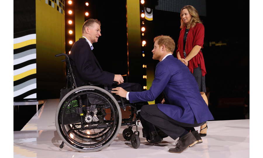 Prince Harry chatted with Trevor Greene, who was injured in Afghanistan, and his wife Debbie at the Air Canada Centre while inspecting the venue for Saturday's opening ceremony.