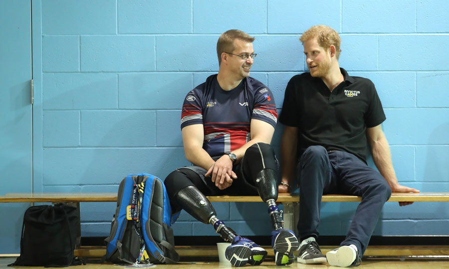 Harry sat with Charlie Walker of the UK armed forces team during the pre-Invictus Games training. 