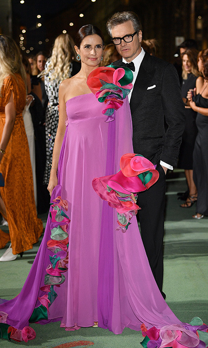 Environmental advocate Livia was positively blooming in a flower-adorned dress alongside husband Colin.