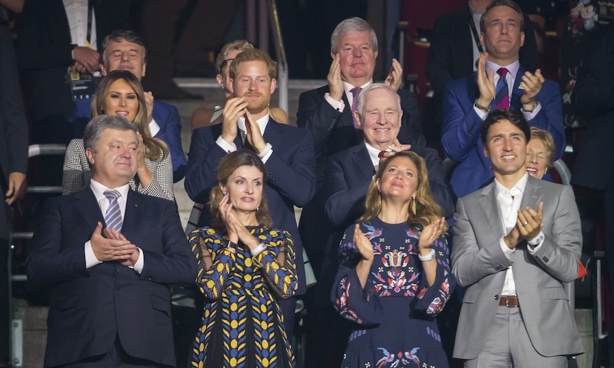 A host of dignitaries joined Prince Harry at the opening ceremony. Front row from left: Ukrainian President Petro Poroshenko and his wife Maryna; Sophie Gregoire-Trudeau and her husband Prime Minister Justin Trudeau. Middle row from left: US first lady Melania Trump; Prince Harry; Governor General David Johnston, and his wife Sharon Johnston. Back row from left: Dr. Ralf Speth, CEO of Land Rover; Ontario Premier Kathleen Wynne; Sir Keith Mills, Chairman of Invictus Games Foundation; and Michael Burns, CEO of IG2017.