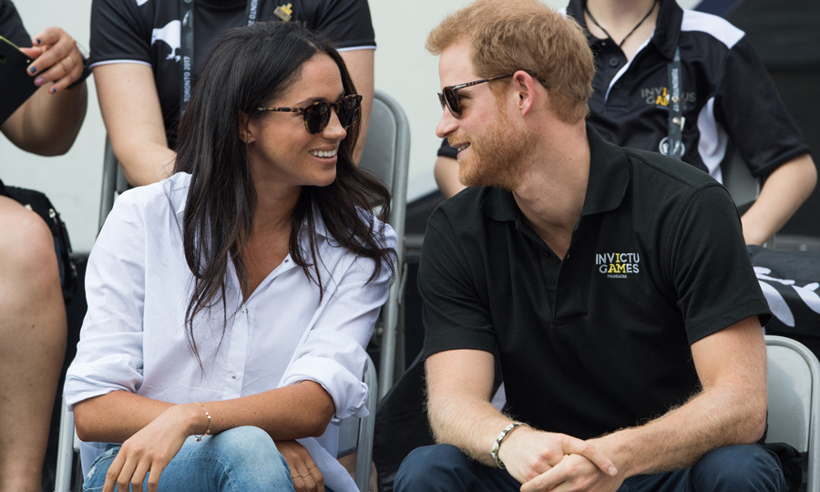 "On September 25, 2017, Prince Harry and Meghan Markle made their first joint appearance during the 2017 Invictus Games in Toronto. The pair arrived hand-in-hand to a wheelchair tennis match and were spotted smiling and laughing throughout the game. Kylie Lawler, whose husband Sean Lawler played for the Australian team during the game, told reporters that the couple ""seemed at home with each other.""