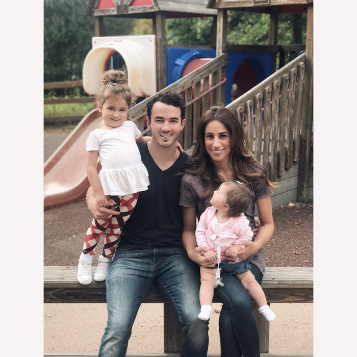 Kevin and Danielle Jonas taught their daughters Alena and Valentina about giving back during their day to kick off the Ronald McDonald House Charities Raise Love campaign. 