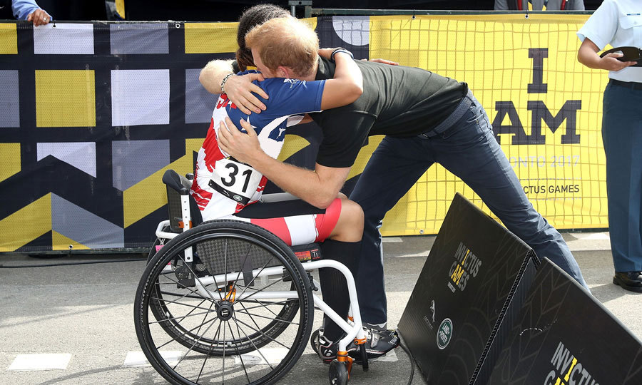 Princess Diana's youngest son congratulated Gabby Graves-Wake with a warm hug at the cycling time trial at High Park in Toronto.