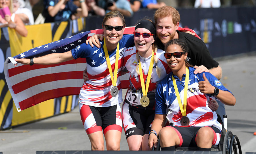 Prince Harry got into the Team USA spirit posing with American competitors at a cycling event during day 4 of the Invictus Games.