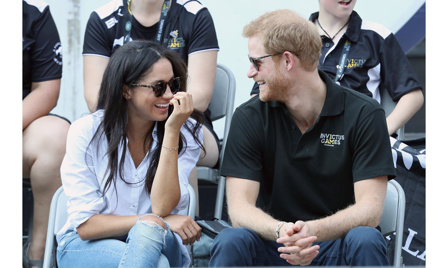 For the day event, Meghan wore a pair of ripped jeans and the 'husband' shirt from good friend Misha Nonoo's Easy 8 Collection.