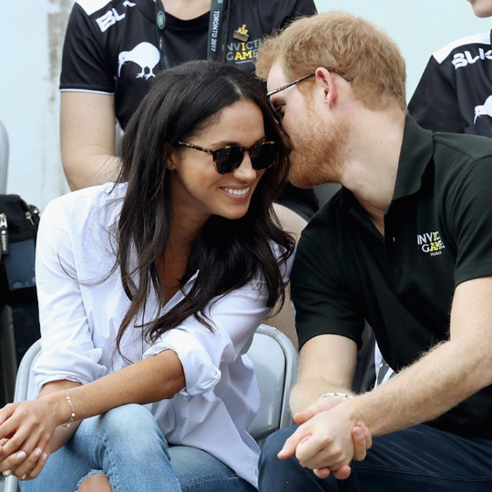 "The royal whispered into his girlfriend's ear during the game. Kylie Lawler, whose husband Sean Lawler played for the Australian team during the game, told reporters that the couple ""seemed at home with each other.""
