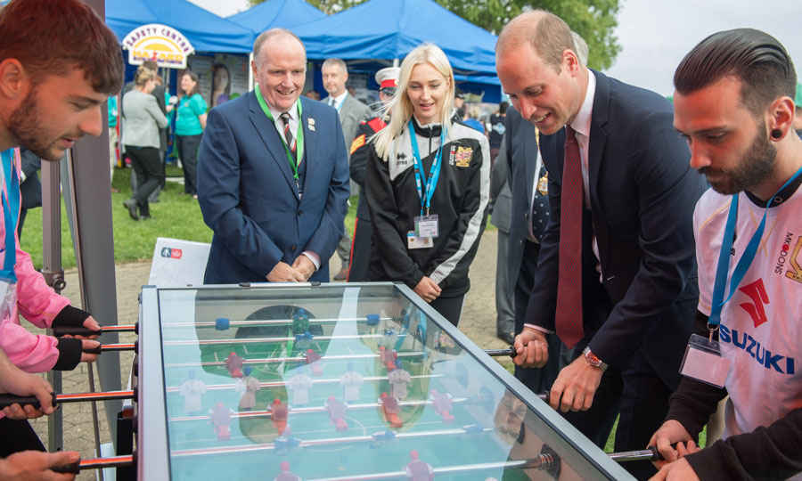"Prince Harry isn't the only one getting in on the sports action. Prince William played a round of table soccer with young people involved in the MK Dons soccer team's program ""Set"" during a visit to Milton Keynes on September 26.