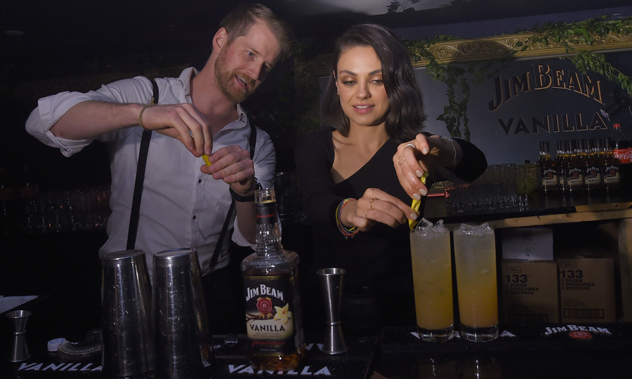 Mila Kunis stepped in as bartender at the Jim Beam Vanilla launch party in NYC on September 25.