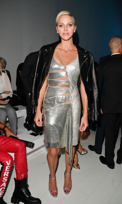 Princess Charlene of Monaco turned heads in a daring silver dress at the Versace show during Milan Fashion Week. 