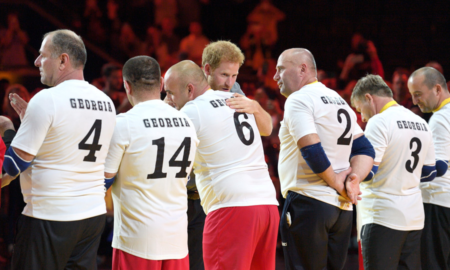There were enough hugs to go around the Georgia Seated Volleyball team. Harry presented the men with gold medals.