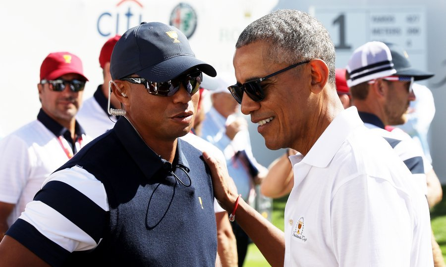Captain's assistant Tiger Woods of the U.S. Team chatted with former President Obama at the Presidents Cup on September 28.