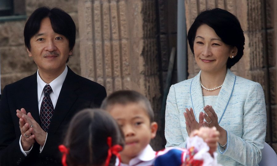 During their visit to Chile, Japan's Prince Akishino and his wife Princess Kiko applauded the students' performance during a visit to a Japanese school in Santiago on September 28.