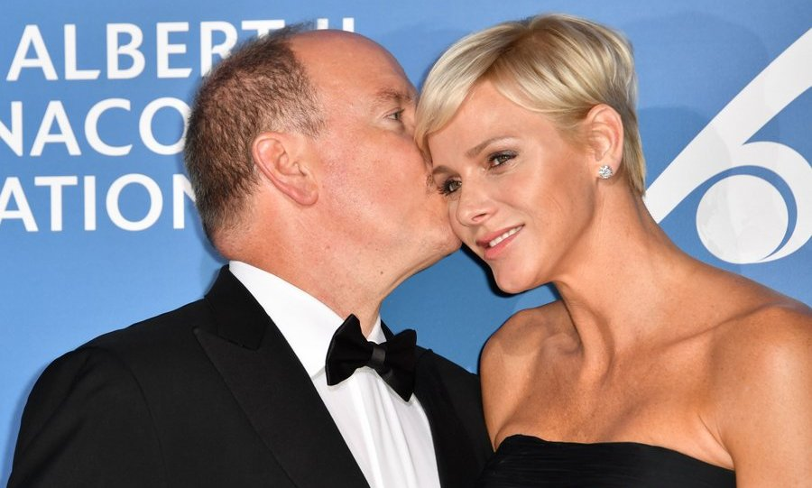 Prince Albert gave wife Princess Charlene a kiss as the royal pair hosted the inaugural Monte-Carlo Gala for the Global Ocean at the Monaco Garnier Opera on September 28.