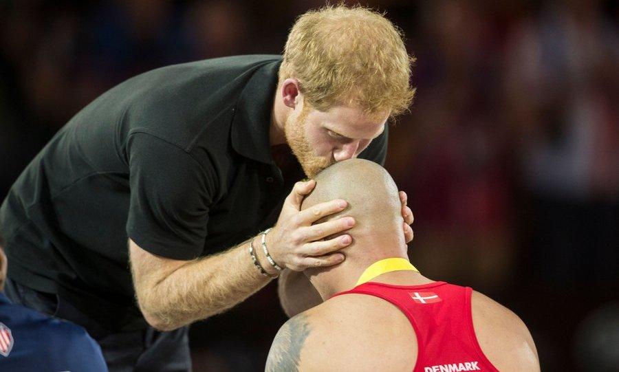 Prince Harry showed his tender side as he kissed the head of wheelchair rugby gold medalist Maurice Manuel of Denmark at the Invictus Games in Toronto, Canada. The eight-day event comes to a close on September 30. 