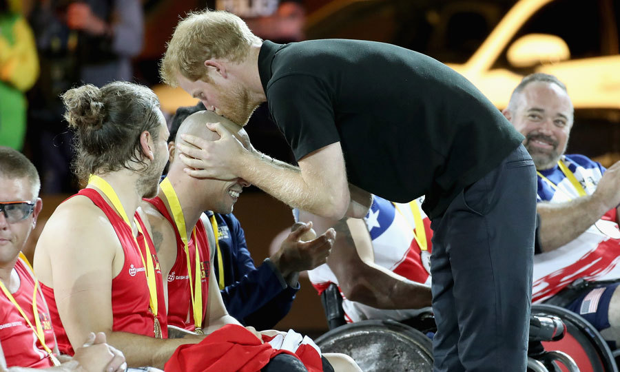 Kiss from a Prince! Harry planted a smooch on the head of a Norwegian rugby team competitor after presenting him with a gold medal.