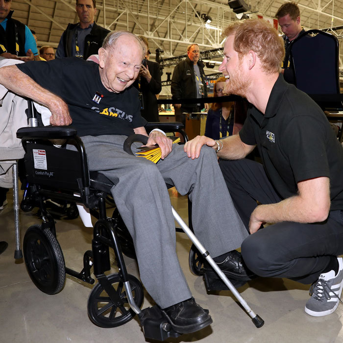 Prince Harry was all smiles as he met with 101-year-old WWII veteran Norm Baker. The two military men discussed the importance of the games.