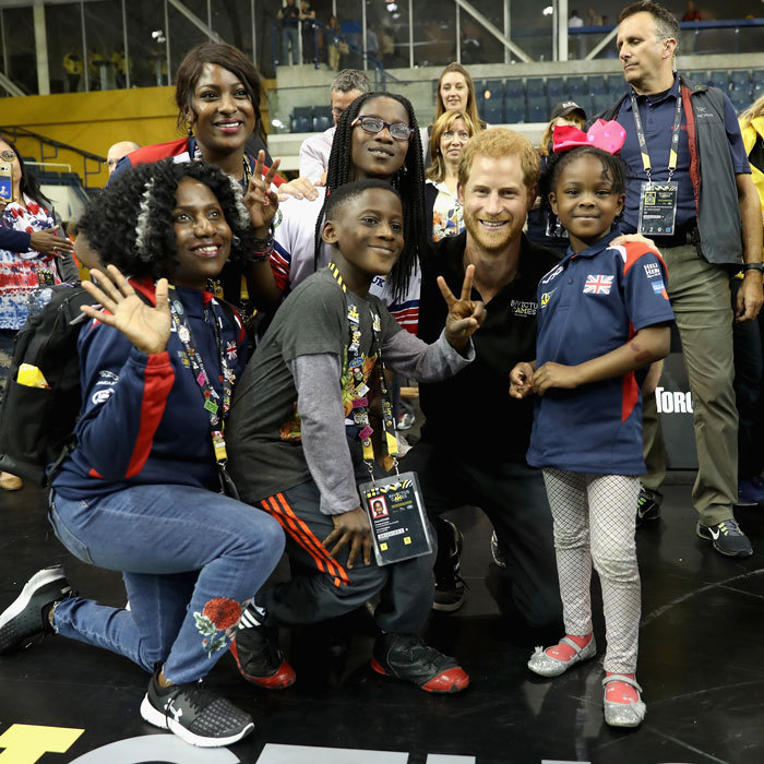 The Prince had more love to go around as he greeted and posed with families after the wheelchair rugby match.