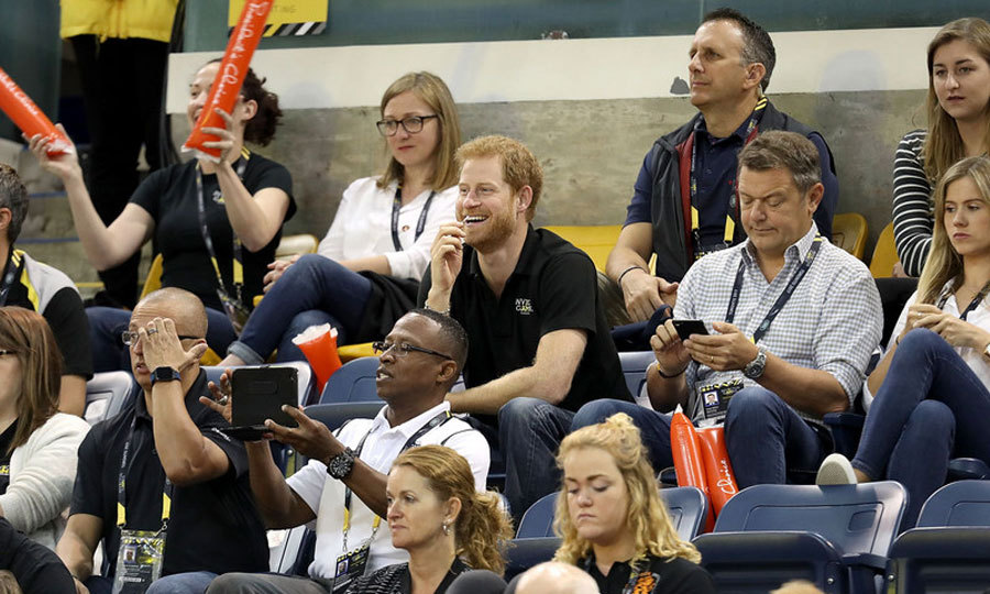 Prince Harry blended into the crowd during the USA vs. Denmark wheelchair basketball final.