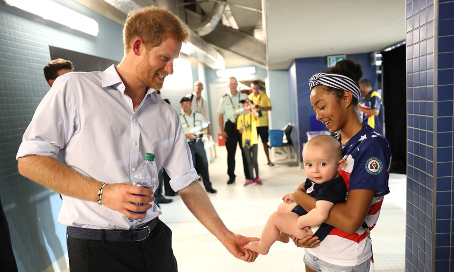 Prince Harry couldn't resist giving this adorable little man a squeeze during the swimming final at the 2017 Invictus Games in Toronto.