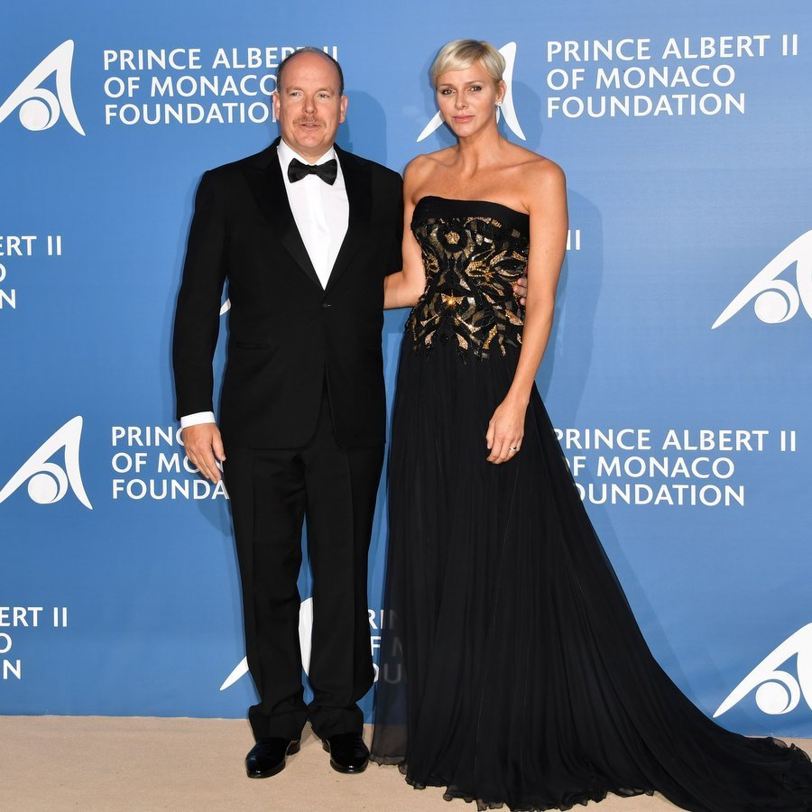 Princess Charlene wore a black and gold strapless Atelier Versace gown to the inaugural Monte-Carlo Gala for the Global Ocean on September 28 with husband Prince Albert.