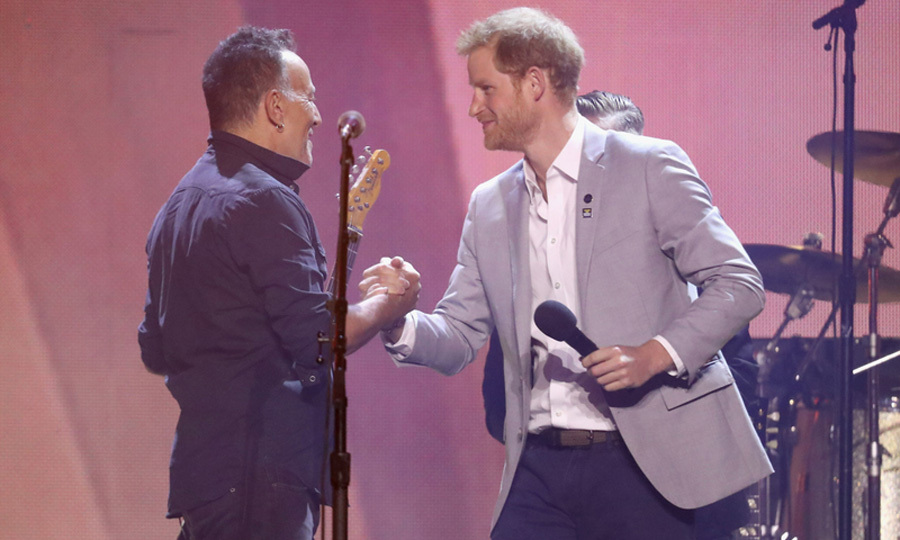 Prince Harry greeted 'The Boss' Bruce Springsteen on stage during the closing ceremony.