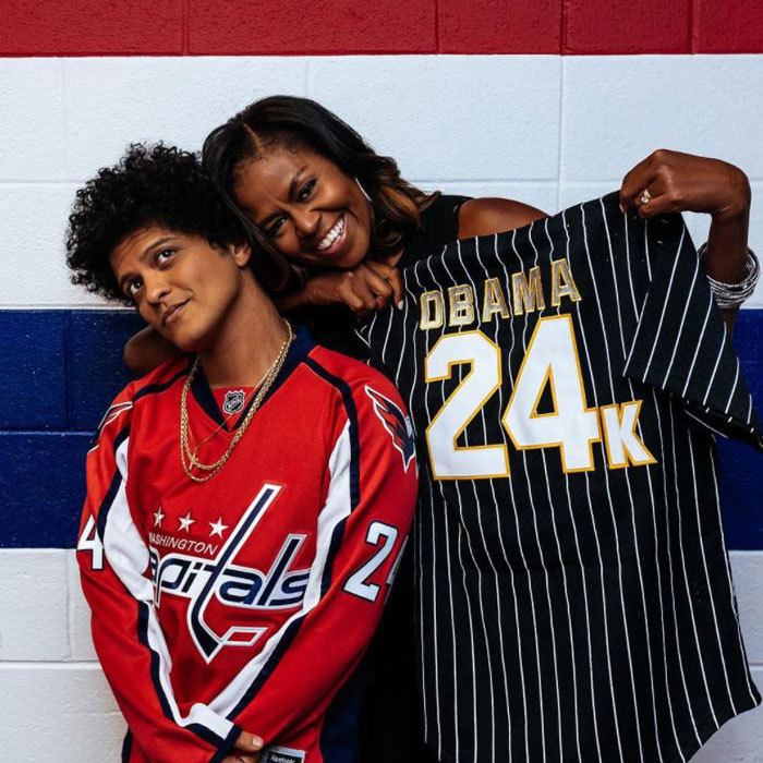 "Bruno Mars had a special guest in the audience at his Washington, D.C. show. The <I>Versace on the Floor</I> singer took to Instagram to show off the former first lady with a personalized jersey and wrote, ""Last Night in D.C. Mrs. Obama came to the concert and blessed us with her presence #24kmagicworldtour #Hooligans.""